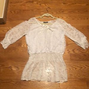 Merchant brand White lacy blouse.
